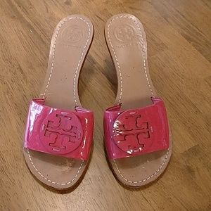 Tory Burch Miller pink patent leather slides.